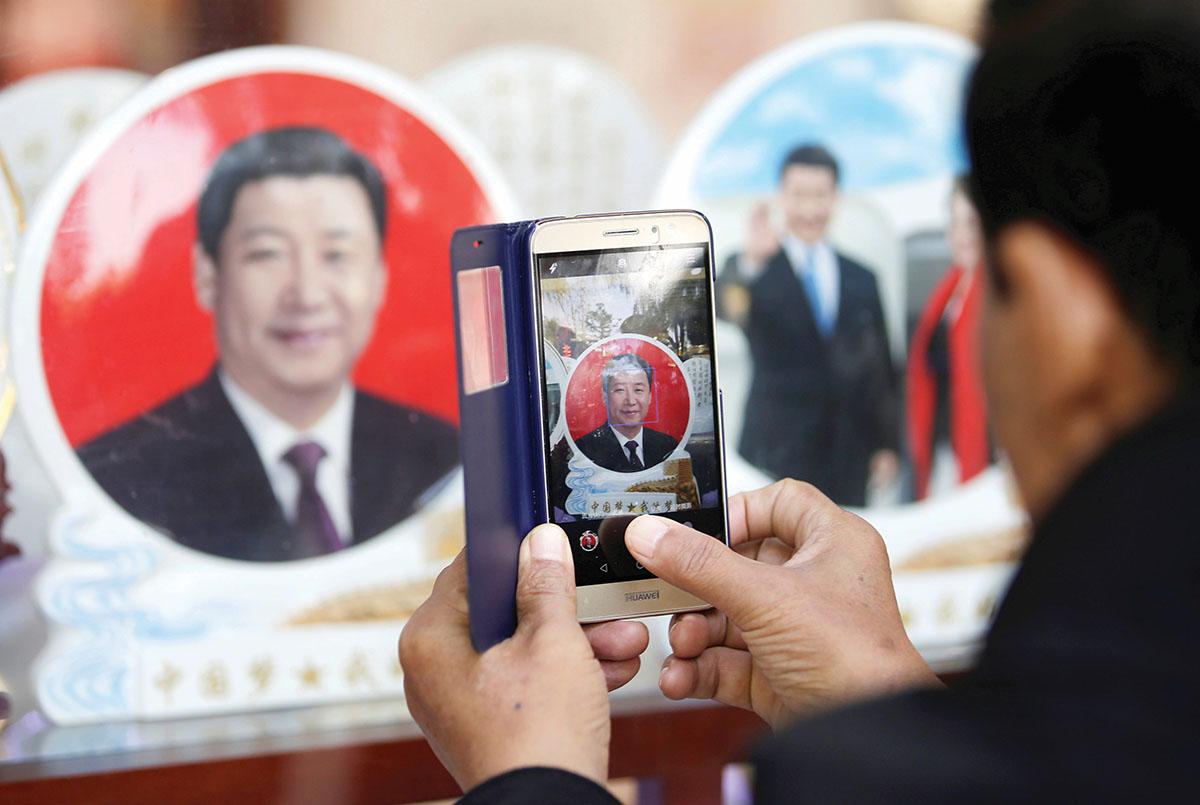 Kinijos vyriausybė siekia vogčiomis formuoti viešąją nuomonę ir tildyti kritiką kitose šalyse